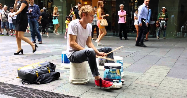 Watch This Street Drummer Beat The Hell Of A Tune Using Paint Buckets.